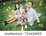 happy young family playing with ... | Shutterstock . vector #711626953