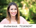 beautiful young girl smiling at ... | Shutterstock . vector #711636247