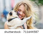 cute pug licks the face of a... | Shutterstock . vector #711644587