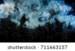 white paint drops from above... | Shutterstock . vector #711663157