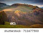 camper van in autumn landscape... | Shutterstock . vector #711677503