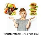 boy chooses between healthy... | Shutterstock . vector #711706153