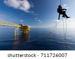 rope access job on the rig of... | Shutterstock . vector #711726007