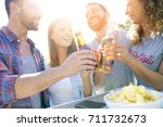 group of friends cheering with... | Shutterstock . vector #711732673
