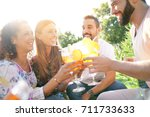 group of friends cheering with... | Shutterstock . vector #711733633