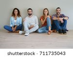 group of friends sitting on... | Shutterstock . vector #711735043