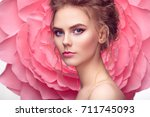 beautiful woman on the... | Shutterstock . vector #711745093