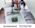 woman painting a cabinet with... | Shutterstock . vector #711761743