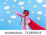 little child plays superhero.... | Shutterstock . vector #711850513