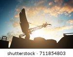 silhouette of satellite dish... | Shutterstock . vector #711854803