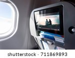 watching movie on an airplane... | Shutterstock . vector #711869893