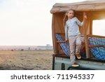 adorable little girl in kenya... | Shutterstock . vector #711945337