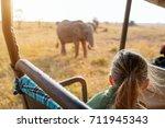 adorable little girl in kenya... | Shutterstock . vector #711945343