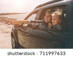 happy family on a road trip in... | Shutterstock . vector #711997633