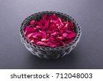 Rose Petals In A Black Basket....