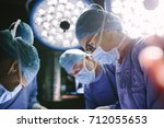 concentrated female surgeon... | Shutterstock . vector #712055653