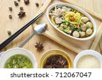egg noodle soup with pork ball  ... | Shutterstock . vector #712067047
