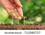 agriculture hand nurturing... | Shutterstock . vector #712080727