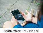 Woman Hands Holding Smartphone...