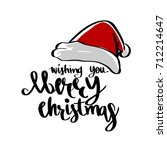 santa hat and wishing you merry ... | Shutterstock .eps vector #712214647