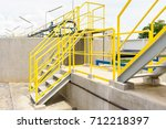 yellow steel staircase with a... | Shutterstock . vector #712218397