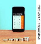 mobile phone used as calculator ... | Shutterstock . vector #712243363