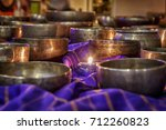 singing bowls lit by candlelight   Shutterstock . vector #712260823