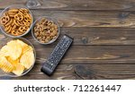 tv remote control  snack chips  ...   Shutterstock . vector #712261447