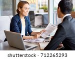business partners discussing... | Shutterstock . vector #712265293
