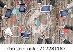 group of people with devices in ... | Shutterstock . vector #712281187