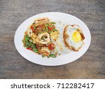 seafood curry  stir basil  and... | Shutterstock . vector #712282417