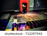 cnc laser cutting of metal ... | Shutterstock . vector #712297543