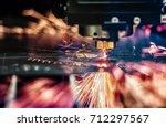 cnc laser cutting of metal ... | Shutterstock . vector #712297567