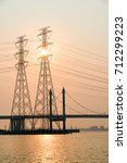 the bridge tower is in the... | Shutterstock . vector #712299223