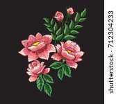 roses embroidery on black... | Shutterstock .eps vector #712304233