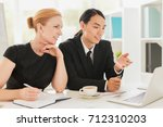 business people discussing... | Shutterstock . vector #712310203