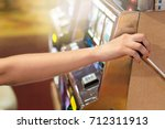 woman pulling the handle on a...   Shutterstock . vector #712311913