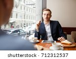 serious man listening to his... | Shutterstock . vector #712312537