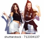 fashion portrait of two smiling ... | Shutterstock . vector #712334137