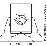 hands holding tablet computer...   Shutterstock .eps vector #712393183