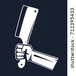 hand holding axe. butcher. | Shutterstock .eps vector #712395433