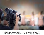 videographer man on duty with...   Shutterstock . vector #712415263