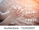 hand of woman praying  pray... | Shutterstock . vector #712425037
