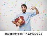ecstatic overjoyed young... | Shutterstock . vector #712430923