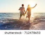 happy young couple enjoying the ... | Shutterstock . vector #712478653