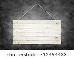 wooden sign with ropes over... | Shutterstock . vector #712494433