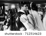 bride and groom kiss each other ... | Shutterstock . vector #712514623