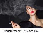 elegant woman  femme fatale in... | Shutterstock . vector #712525153