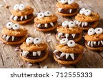 toothed monsters of cookies... | Shutterstock . vector #712555333