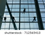 professional window cleaners... | Shutterstock . vector #712565413